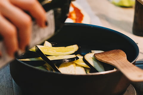 person-cooking-on-black-pot-thumbnail-1
